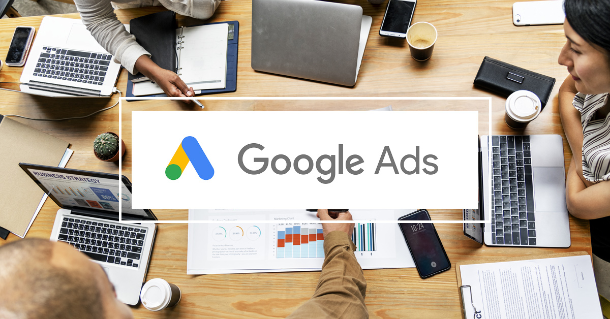 computers in office. Google ADS letters in the middle